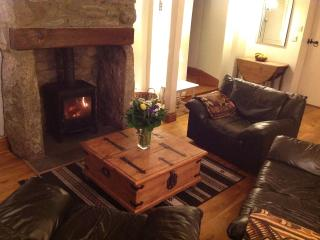 Cosy cottage lounge, the perfect place to relax and unwind in front of the wood burner