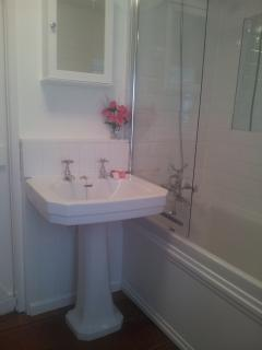 Classic cottage bathroom with combination bath and shower, toilet, bidet and heated towel rail