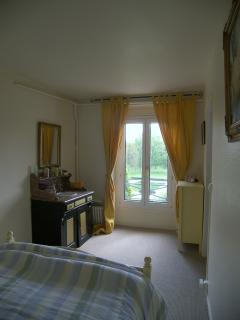 Bedroom - Double. Excellent view of the garden, lake and swimming pool