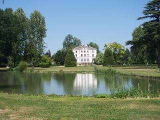 The Chateau viewed from the garden with the lake in the foreground