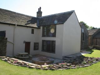 Rear of the house- garden view with patio and picnic table for 8 plus garden chairs,a sunny area