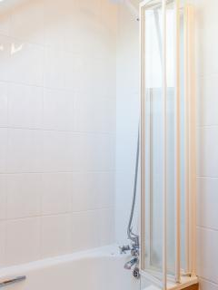 Bath with shower above
