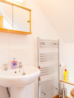 Bathroom with bath, shower. heated towel rail, sink and tolet