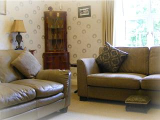 Lounge with 2 comfortable sofas overlooking pretty garden
