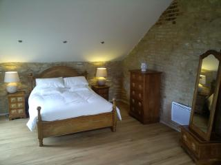 Stunning Main Bedroom, with exposed stone walls and a vaulted ceiling. Amazing views to wake up to.