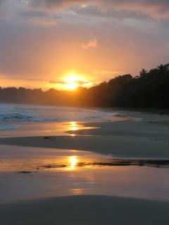 Our beach with the sun rising over Manzanillo