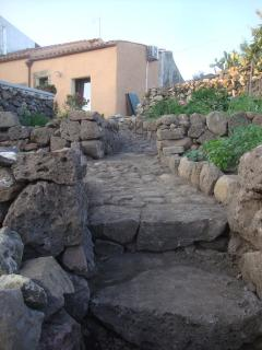traditional stone paths and dry stone walls to the herb gardens