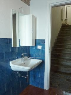 Bathroom and stairways up to entrance