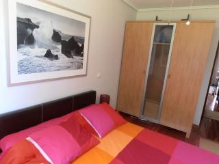 Dormitorio cama de 1,50 y armario doble
