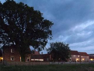 The Barn House at Broadgate Farm at dusk