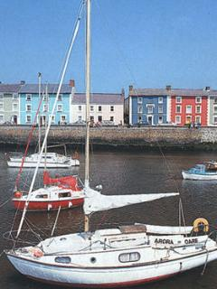 Aberaeron, the picturesque harbour village is 6 miles south along the coastline
