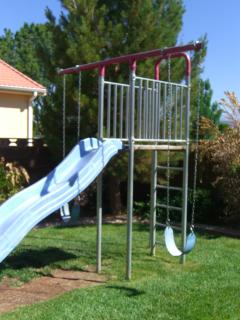 Jungle gym with slide and swings