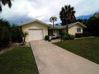Ground level home with pool and dock, Sanibel Island