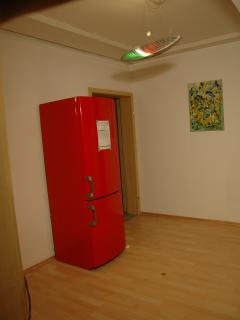 Refrigerator in the hall between both rooms