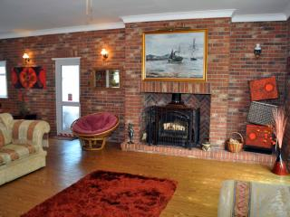 Downstairs lounge with wood burner