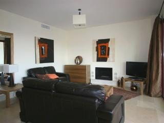 Spacious living area, well furnished leather sofas, flatscreen sat TV, DVD.CD