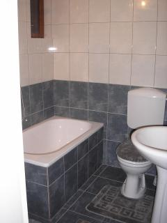 Bath with shower attachment, toilet and wash basin. Washing machine. All newly fitted.