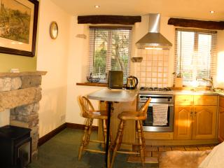 Lounge/kitchen diner with patio doors leading to patio. Underfloor heating. Large freeview TV &
