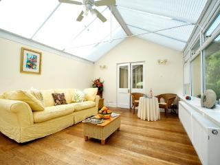 Large Conservatory overlooking copse, patio, gardens, centrally heated with full blinds.