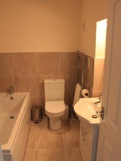 Upstairs Bathroom with bath, separate walk in shower cubicle, wash hand basin and loo.