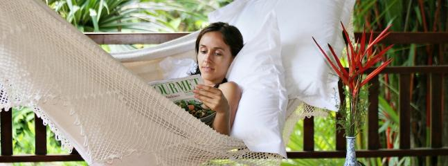 A hammock, a magazine, a breeze, and a sleep can be just the what's needed on holiday.