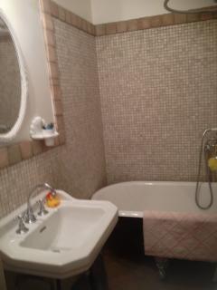 Bathroom with clawfoot tub/shower, sink, towel warmer