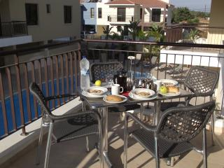Breakfast in the morning sunshine with pool and countryside views.
