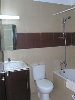 Family bathroom with shower.