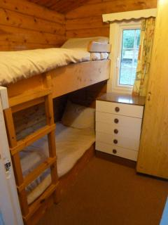 Bunk bedroom, comfortably sleep adults and children alike, with heating and storage.