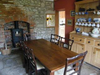 'Farmhouse' style dining room with wood burner, has additional 8 seater table