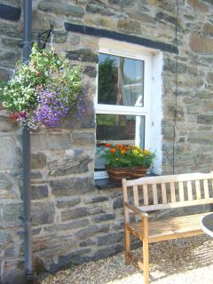 The front of the cottage enjoys a sunny aspect all day, a lovely place to sit and chill out.