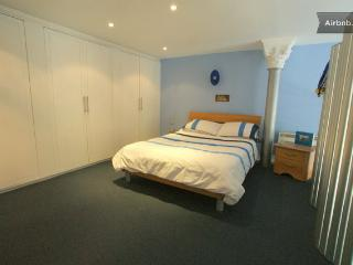 Main bedroom with fitted wardrobes and ensuite bathroom.