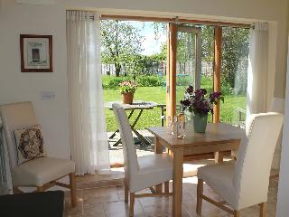 The dining area has French windows leading out to the garden