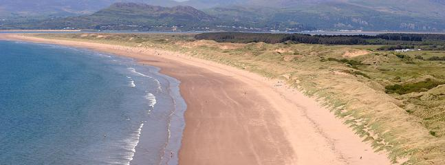Harlech Beach come and enjoy four miles of golden sand.