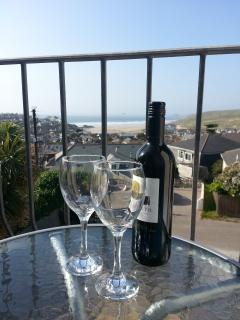 Relax with a glass of wine on the balcony & watch the waves