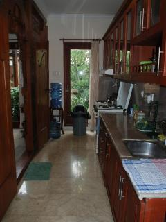 Kitchen viewed from the fridge end, free drinking water provided. Iron and ironing board provided