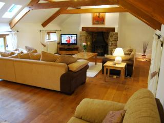 The stunning sitting room/lounge has oak beams and bags of character. Great to put your feet up!