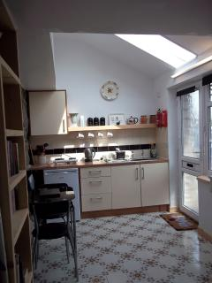Kitchen and Dining area in the studio with a wonderful roof glass window