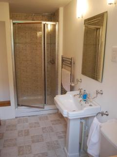 The luxury ensuite for bedroom two also has a roomy well-equipped shower.