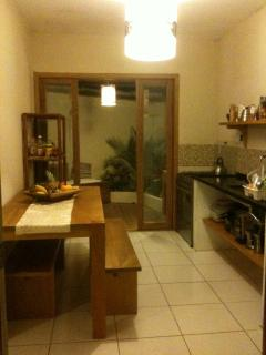Fully equipped kitchen with large 6 stove oven and outdoor deck area