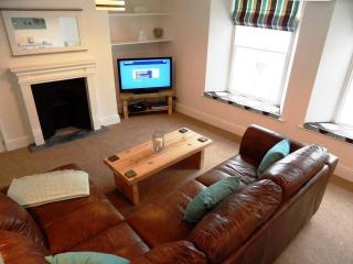 Lovely lounge with feature fireplace, comfy leather sofas and armchairs, LCD TV and DVD