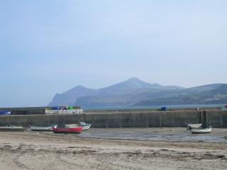 Breakwater and moutains in the distance taken from the cottage door