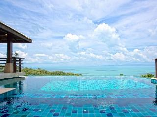 The blue on blue infinity pool with views across the Gulf of Thailand