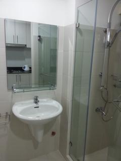 A function bathroom with a washer
