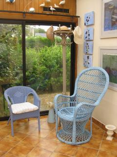 The blue wicker furniture can be used in the garden.