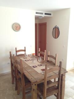 The Spacious Dining Table & Chairs will comfortably seat six people