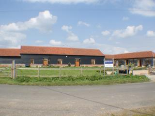 The three barns with spacious front garden, with the Cart Lodge on the right.