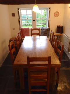 Dining room with oak furniture and south facing views