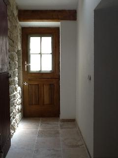 The door onto the side terrace, between kitchen and laundry room
