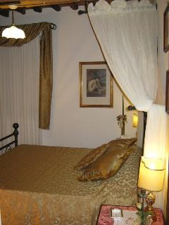 Double bedroom with wrought iron bed